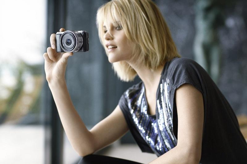 woman with a Sony Nex digicam
