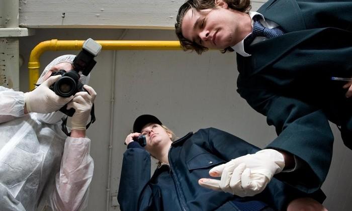 crime scene photographer and two investigators
