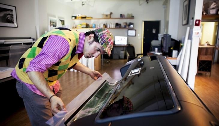 man printing large photo