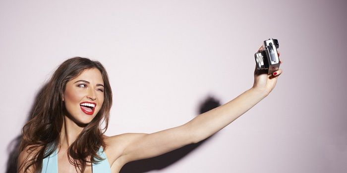 woman taking a selfie with her camera