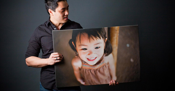 man holding the photograph of a girl