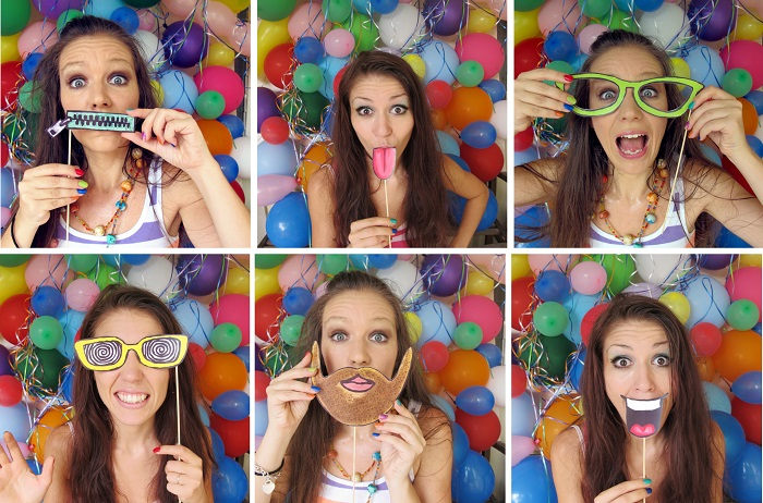 girl using props in a photo booth