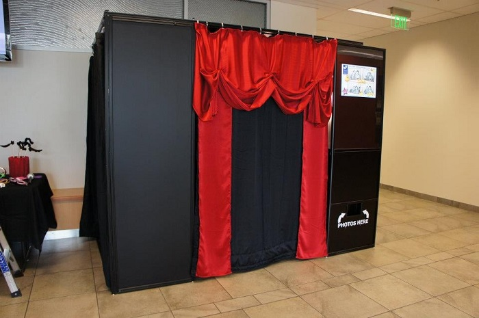 black photo booth with red courtains