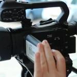 woman using a Canon XA20 camcorder