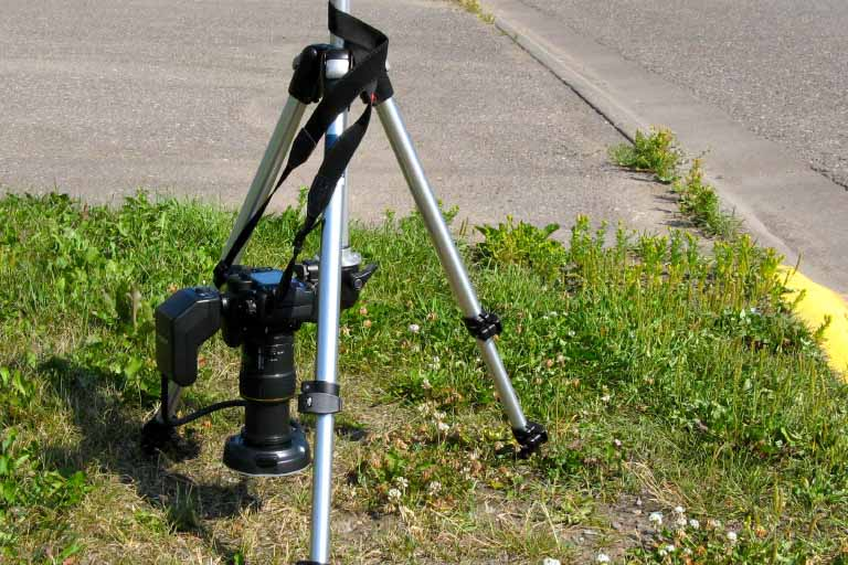 a camera set up for taking a picture on the ground